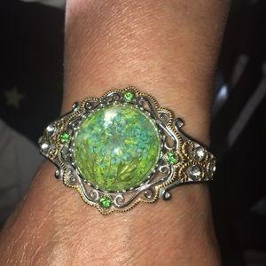 silver and gold gemstone flower bracelet